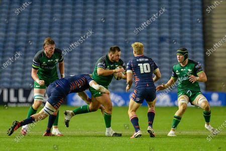 Jack Aungier (#3) of Connacht Rugby tries to break the tackle of Andrew Davidson (#5) of Edinburgh Rugby during the Guinness Pro 14 match between Edinburgh Rugby and Connacht Rugby at BT Murrayfield, Edinburgh
