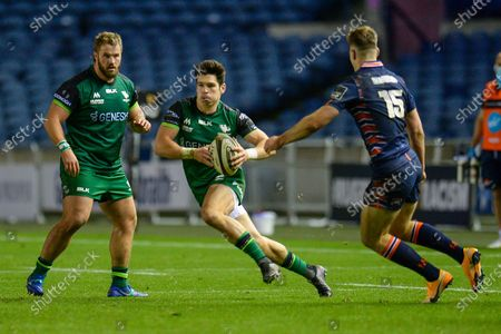 Alex Wooton (#11) of Connacht Rugby runs at Jack Blain (#15) of Edinburgh Rugby during the Guinness Pro 14 match between Edinburgh Rugby and Connacht Rugby at BT Murrayfield, Edinburgh
