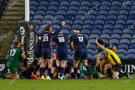 TRY Henry Pyrgos (#21) of Edinburgh Rugby celebrates as Andrew Davidson (#5) of Edinburgh Rugby scores a try during the Guinness Pro 14 match between Edinburgh Rugby and Connacht Rugby at BT Murrayfield, Edinburgh