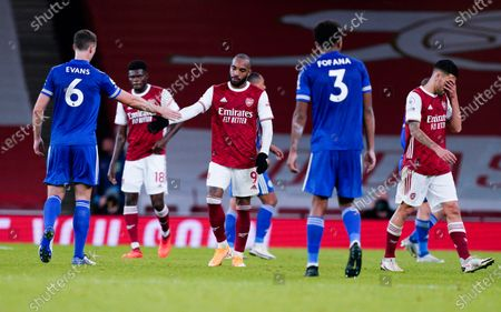 Arsenal's Alexandre Lacazette congratulates Leicester's Jonny Evans, left, after the English Premier League soccer match between Arsenal and Leicester City at Emirates Stadium in London, England