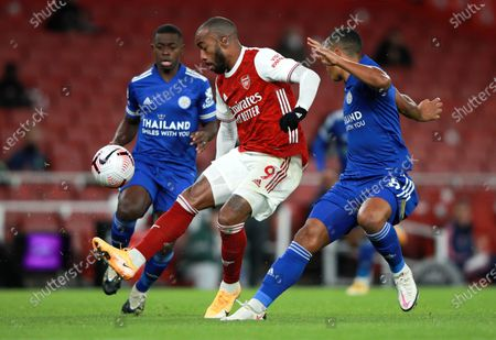 Arsenal's Alexandre Lacazette and Leicester's Youri Tielemans, right, battle for the ball during the English Premier League soccer match between Arsenal and Leicester City at Emirates Stadium in London, England
