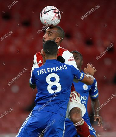 Arsenal's Alexandre Lacazette heads the ball away from Leicester's Youri Tielemans during the English Premier League soccer match between Arsenal and Leicester City at Emirates Stadium in London, England