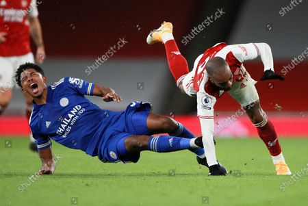 Leicester's Wesley Fofana, left, reacts as he collides with Arsenal's Alexandre Lacazette during the English Premier League soccer match between Arsenal and Leicester City at Emirates Stadium in London, England