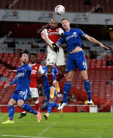 Leicester's Jonny Evans, right, and Arsenal's Alexandre Lacazette leap to head the ball during the English Premier League soccer match between Arsenal and Leicester City at Emirates Stadium in London, England