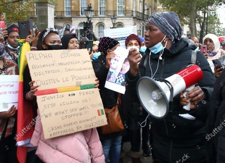 An angry protester addresses the crowd using a megaphone at the rally. Guineans in UK protest outside Downing Street after Guinea President Alpha Conde was re-elected with opposition claims that the election was rigged.