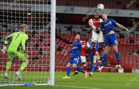 Alexandre Lacazette (2-R) of Arsenal in action against Jonny Evans (R) of Leicester during the English Premier League soccer match between Arsenal FC and Leicester City in London, Britain, 25 October 2020.