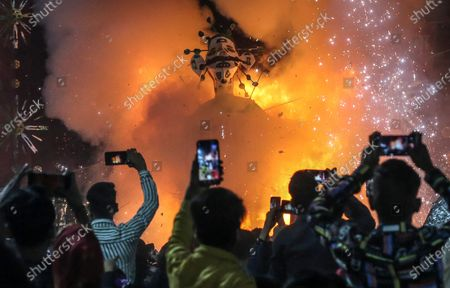 An effigy of demon king Ravana decorated with a coronavirus burns during the Dussehra festival celebrations in New Delhi, India, 25 October 2020. Limited people were allowed inside the Dussehra festival celebration area due to Indian government guidelines over the Covid-19 pandemic. Dussehra is an annual Hindu religious festival, which follows the nine-day festival of Navratri and marks the victory of the mythological Hindu God Lord Rama over the evil demon king Ravana.