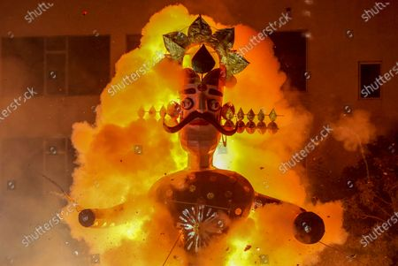 An effigy of demon king Ravana burns during the Dussehra festival celebrations in New Delhi, India, 25 October 2020. Limited people were allowed inside the Dussehra festival celebration area due to Indian government guidelines over the Covid-19 pandemic. Dussehra is an annual Hindu religious festival, which follows the nine-day festival of Navratri and marks the victory of the mythological Hindu God Lord Rama over the evil demon king Ravana.