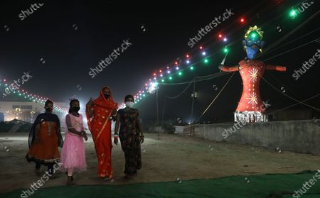 Indian people arrive to attend Dussehra festival celebrations in New Delhi, India, 25 October 2020. Limited people were allowed inside the Dussehra festival celebration area due to Indian government guidelines over the Covid-19 pandemic. Dussehra is an annual Hindu religious festival, which follows the nine-day festival of Navratri and marks the victory of the mythological Hindu God Lord Rama over the evil demon king Ravana.