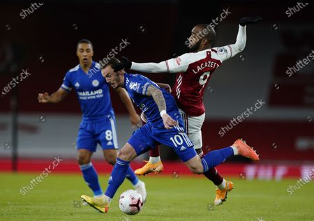 Stock Image of Alexandre Lacazette (R) of Arsenal in action against James Maddison (C) of Leicester during the English Premier League soccer match between Arsenal FC and Leicester City in London, Britain, 25 October 2020.