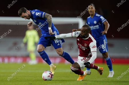Alexandre Lacazette (C) of Arsenal in action against James Maddison (L) of Leicester during the English Premier League soccer match between Arsenal FC and Leicester City in London, Britain, 25 October 2020.