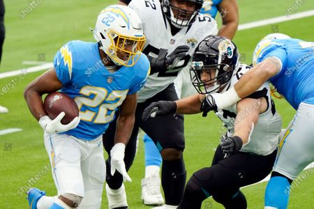 Los Angeles Chargers running back Justin Jackson (22) carries against the Jacksonville Jaguars during the first half of an NFL football game, in Inglewood, Calif