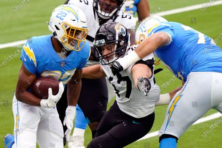 Los Angeles Chargers running back Justin Jackson (22) runs past Jacksonville Jaguars middle linebacker Joe Schobert (47) gets blocked by offensive guard Ryan Groy (72) during the first half of an NFL football game, in Inglewood, Calif