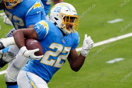 Los Angeles Chargers running back Justin Jackson runs against the Jacksonville Jaguars during the first half of an NFL football game, in Inglewood, Calif