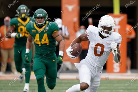 Stock Photo of Texas' Tarik Black (0) runs after a catch against Baylor during the first half of an NCAA college football game in Austin, Texas