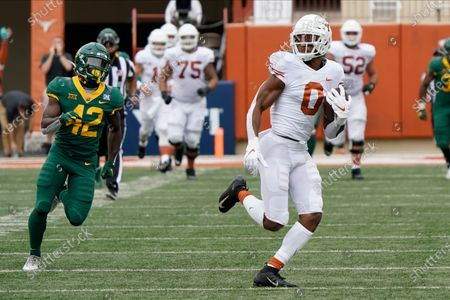 Texas' Tarik Black (0) runs after a catch against Baylor during the first half of an NCAA college football game in Austin, Texas
