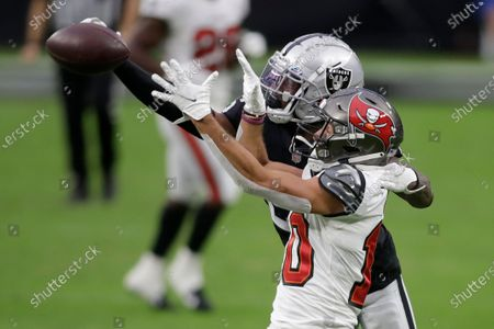 Las Vegas Raiders cornerback Nevin Lawson (26) guards Tampa Bay Buccaneers wide receiver Scott Miller (10) during the first half of an NFL football game, in Las Vegas