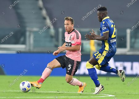Stock Picture of Juventus' Arthur (L) and Verona's Ronaldo Vieira (R) in action during the Italian Serie A soccer match between Juventus FC and Hellas Verona FC in Turin, Italy, 25 October 2020.