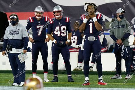 New England Patriots quarterback Cam Newton (1) watches from the sideline after being replaced by Jarrett Stidham in the second half of an NFL football game against the San Francisco 49ers, in Foxborough, Mass