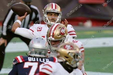 San Francisco 49ers quarterback Jimmy Garoppolo passes against the New England Patriots in the first half of an NFL football game, in Foxborough, Mass