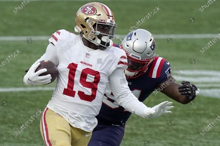 San Francisco 49ers wide receiver Deebo Samuel (19) runs from New England Patriots linebacker Ja'Whaun Bentley after catching a pass in the first half of an NFL football game, in Foxborough, Mass