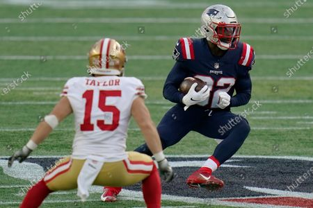 New England Patriots defensive back Devin McCourty, right, runs from San Francisco 49ers wide receiver Trent Taylor (15) after intercepting a pass in the first half of an NFL football game, in Foxborough, Mass