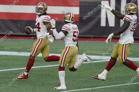 San Francisco 49ers linebacker Fred Warner, left, celebrates his interception with teammates in the first half of an NFL football game against the New England Patriots, in Foxborough, Mass