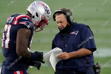 New England Patriots head coach Bill Belichick, right, gives instructions to linebacker Ja'Whaun Bentley (51) in the first half of an NFL football game against the San Francisco 49ers, in Foxborough, Mass
