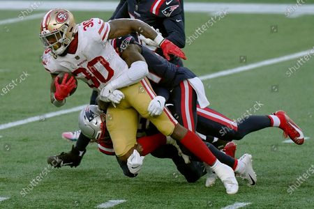 San Francisco 49ers running back Jeff Wilson Jr. gains yardage against the New England Patriots in the first half of an NFL football game, in Foxborough, Mass