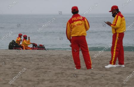 Lifeguards from the National Police of Peru guard Aguadulce beach, in Lima, Peru, 25 October 2020. The city of Lima and the neighboring province of Callao closed their beaches to bathers, a few weeks before the start of the summer season, to prevent the spread of Covid-19 and reduce the possibility of a second wave of the disease. With more than 886,000 confirmed cases of the pandemic and more than 34,000 deaths, the Peruvian authorities ordered the closure of the beaches during the weekends.
