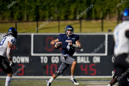 Rice University quarterback Mike Collins (4) looks to pass during an NCAA football game against Middle Tennessee on in Houston
