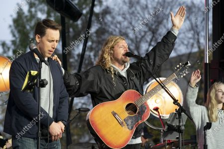 Stock Photo of Christian musician Sean Feucht of California have a prays along with Sen. Josh Hawley, R-Mo., left, during a rally at the National Mall in Washington