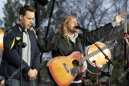 Christian musician Sean Feucht of California have a prays along with Sen. Josh Hawley, R-Mo., left, during a rally at the National Mall in Washington