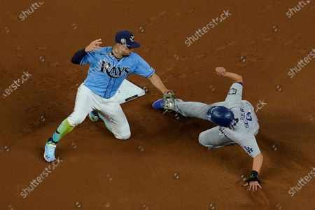 Los Angeles Dodgers' Corey Seager steals second past Tampa Bay Rays shortstop Willy Adames during the first inning in Game 5 of the baseball World Series, in Arlington, Texas