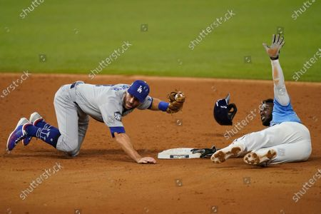 Tampa Bay Rays' Randy Arozarena gets caught stealing by Los Angeles Dodgers second baseman Chris Taylor during the third inning in Game 5 of the baseball World Series, in Arlington, Texas