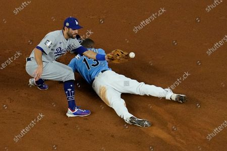 Tampa Bay Rays' Manuel Margot steals second past Los Angeles Dodgers second baseman Chris Taylor during the fourth inning in Game 5 of the baseball World Series, in Arlington, Texas