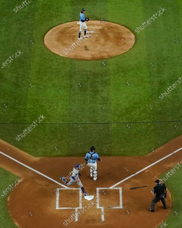 Los Angeles Dodgers' Mookie Betts scores past Tampa Bay Rays catcher Mike Zunino on a hit by Corey Seager during the first inning in Game 5 of the baseball World Series, in Arlington, Texas