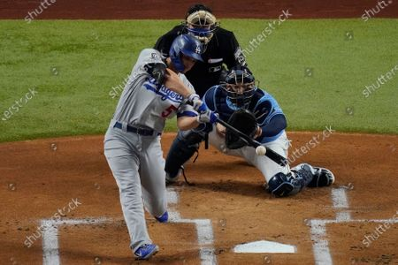 Los Angeles Dodgers' Corey Seager hits a RBI-single against the Tampa Bay Rays during the first inning in Game 5 of the baseball World Series, in Arlington, Texas