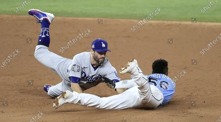 Tampa Bay Rays baserunner Randy Arozarena (R) is tagged out by Los Angeles Dodgers second baseman Chris Taylor (L) as he tried to steal second base on Brandon Lowe's strikeout  in the bottom of the third inning of Major League Baseball's World Series Game five at Globe Life Field in Arlington, Texas, USA, 25 October 2020. The best-of-seven series is tied 2-2.