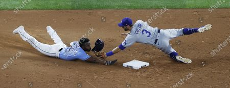 Tampa Bay Rays baserunner Randy Arozarena (L) is tagged out by Los Angeles Dodgers second baseman Chris Taylor (R) as he tried to steal second base on Brandon Lowe's strikeout  in the bottom of the third inning of Major League Baseball's World Series Game five at Globe Life Field in Arlington, Texas, USA, 25 October 2020. The best-of-seven series is tied 2-2.