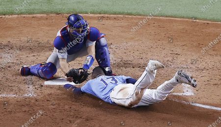 Tampa Bay Rays baserunner Manuel Margot (R) is tagged out by Los Angeles Dodgers catcher Austin Barnes (R) as he tried to steal home plate in the bottom of the fourth inning of Major League Baseball's World Series Game five at Globe Life Field in Arlington, Texas, USA, 25 October 2020. The best-of-seven series is tied 2-2.