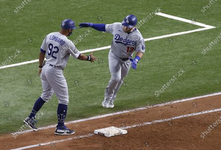 Los Angeles Dodgers batter Max Muncy (R) celebrates with first base coach George Lombard (L) after hitting a solo home run against the Tampa Bay Rays in the top of the fifth inning of Major League Baseball's World Series Game five at Globe Life Field in Arlington, Texas, USA, 25 October 2020. The best-of-seven series is tied 2-2.