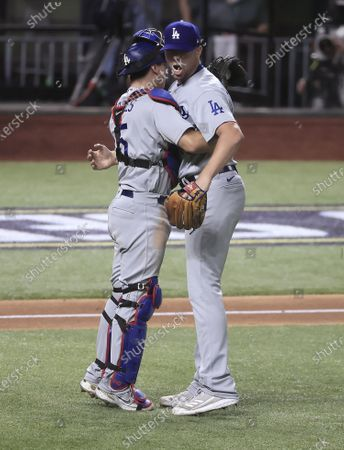 Los Angeles Dodgers pitcher Blake Treinen (R) and catcher Austin Barnes (L) celebrate after defeating the Tampa Bay Rays in Major League Baseball's World Series Game five at Globe Life Field in Arlington, Texas, USA, 25 October 2020. The Dodgers lead the best-of-seven series 3-2.