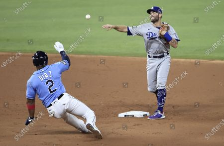 Los Angeles Dodgers second baseman Chris Taylor relays to first base after forcing out Tampa Bay Rays baserunner Yandy Diaz (L) to complete a double play in the bottom of the first inning of Major League Baseball's World Series Game five at Globe Life Field in Arlington, Texas, USA, 25 October 2020. The best-of-seven series is tied 2-2.