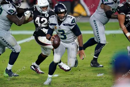 Seattle Seahawks quarterback Russell Wilson (3) scrambles as Arizona Cardinals outside linebacker Devon Kennard (42) pursues during the second half of an NFL football game, in Glendale, Ariz