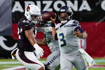 Seattle Seahawks quarterback Russell Wilson (3) throws as Arizona Cardinals outside linebacker Devon Kennard (42) defends during the first half of an NFL football game, in Glendale, Ariz