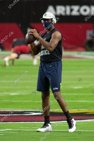 Seattle Seahawks quarterback Geno Smith (7) warms up prior to an NFL football game against the Arizona Cardinals, in Glendale, Ariz