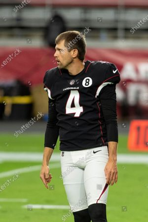 Arizona Cardinals punter Andy Lee (4) warms up prior to an NFL football game against the Seattle Seahawks, in Glendale, Ariz