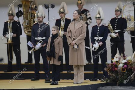 King Carl Gustaf, Crown Princess Victoria and Princess Estelle walk the new Slussbridge.The new bridge connects the Stockholm Old Town with the sothern part of the town