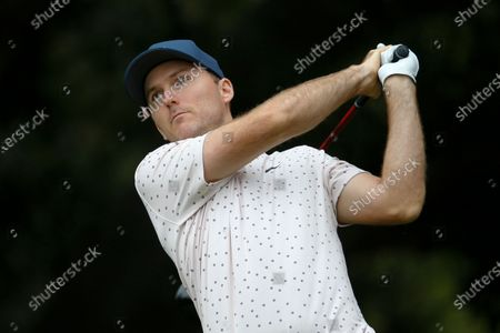 Russell Henley hits from the second tee during the final round of the Zozo Championship golf tournament, in Thousand Oaks, Calif